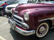 Partial view of a dark red Chevrolet De Luxe coupe Stock Image