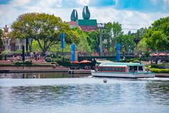 Partial view of Disney Swan Hotel and taxi boat sailing on lake at Epcot in Walt Disney World. royalty free stock photos