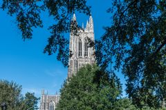 Partial view of the Duke Chapel tower in early fall stock photos
