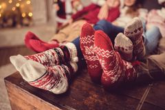 Family in wool socks. Partial view of feet in colorful wool socks Stock Photos
