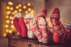 Family in wool socks. Partial view of feet in colorful wool socks Royalty Free Stock Photography