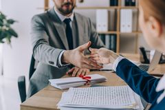 partial view of lawyers shaking hands on meeting stock photos