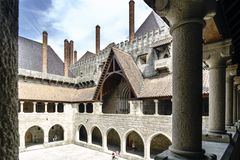 Partial view of the main courtyard of the palace of the Dukes of Braganza from the arcaded gallery on the first floor and with tou. Guimaraes, Portugal. August Stock Photo