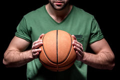 Partial view of man holding basketball ball in hands Royalty Free Stock Image