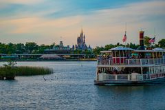 Free Partial View Of Cinderella`s Castle And Disney Ferry Boat On Colorful Sunset Bakcground At Walt Disney World  Area  1 Stock Image - 146100241