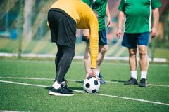 partial view of old men playing football together Royalty Free Stock Images