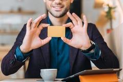 Businessman showing business card Stock Photos