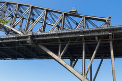 Partial view of Sydney Harbour Bridge with people walking on top Royalty Free Stock Photo