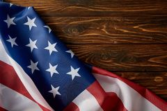 Partial view of united states of america flag on wooden surface stock photo