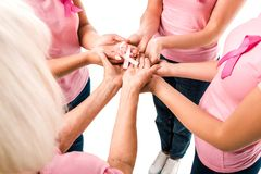 partial view of women in pink t-shirts holding breast cancer awareness ribbon stock image