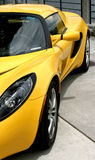 Partial view of yellow exotic sports car. Side view of yellow exotic sports car Royalty Free Stock Image