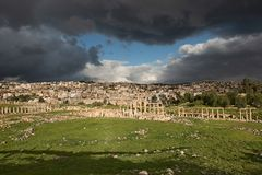 Partial vista of the ancient city of Gerasa after a storm. With dark grey clouds Royalty Free Stock Photography