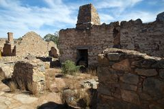 Partial walls and rooms with fireplace and chimney at abandoned settlement. Autumn in rural South Australia around the abandoned Kanyaka station homestead stock photo