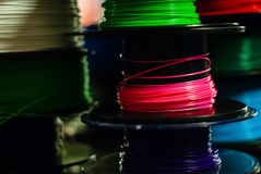 Partially blurred background - coils with a multi-colored thermoplastic royalty free stock photos