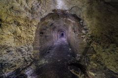 Partially concreted tunnel of constructing mine. Stock Photos