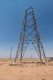 Partially constructed electrical tower in desert Stock Photo