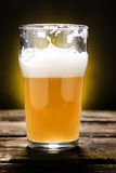 Partially Consumed Farmhouse Ale. One pint of partially consumed farmhouse ale Royalty Free Stock Photo