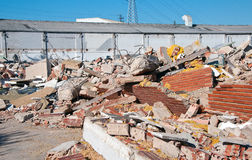 Partially demolished factory in industrial area Royalty Free Stock Photos