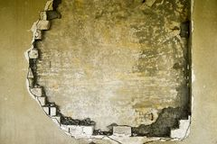 Partially destroyed wall inside an industrial building under demolition Stock Images
