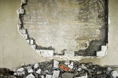 Partially destroyed wall inside an industrial building under demolition Royalty Free Stock Photography