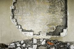 Partially destroyed wall inside an industrial building under demolition Royalty Free Stock Images