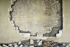 Partially destroyed wall inside an industrial building under demolition Stock Photo