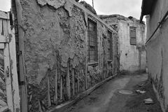 Partially destroyed the wall of the old buildings. Black and white view Royalty Free Stock Images