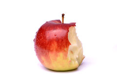 Partially eaten apple. Closeup of partially eaten red apple isolated on white background royalty free stock photography