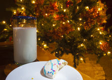 Partially eaten cookie by a Christmas tree Royalty Free Stock Photography