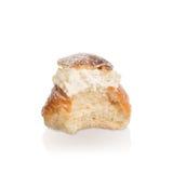 Partially Eaten cream bun. Royalty Free Stock Images
