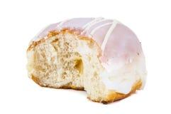 Partially eaten glazed donut on white background Stock Photos