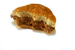 Partially eaten hamburger. Remains of a partially eaten cooked burger Stock Photos