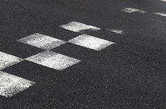 Partially erased road. Markings white squares about the approaching sleeping policeman, photo close-up of part of the asphalt road stock image