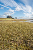 Partially flooded area with a large barn in the background Stock Photography