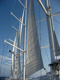 Partially furled sails on large ship Royalty Free Stock Images