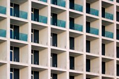 Partially installed glass railings on balconies of a new building.  Royalty Free Stock Photography