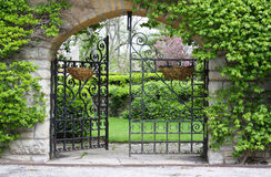 Partially open gate. A partially open gate, entrance to a garden Royalty Free Stock Images