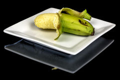 Partially pealed banana ripe and ready to eat Stock Images