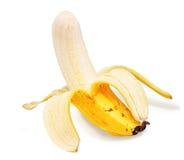 Partially peeled banana. Single partially peeled ripe banana with white studio background Stock Images