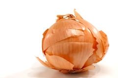 Partially peeled onion Royalty Free Stock Images