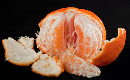 Partially peeled orange Royalty Free Stock Images