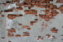 Partially plastered wall with red bricks Royalty Free Stock Photo