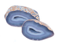 Partially polished blue lace agate geode. With crystaline druzy center isolated on white background Stock Photography