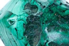 Partially polished green free form bullseye malachite specimen. Isolated on white background stock images