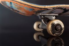 Partially seen skateboard on glance background Stock Images