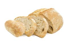 Partially sliced wheat sourdough bread with bran Royalty Free Stock Photography