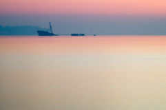 Partially sunken ship after sunset dusk Stock Photography