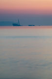 Partially sunken ship in after sunset haze. Vertical view Stock Image