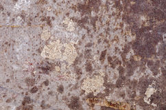 Partially wet and weathered industrial surface. A close-up of a rough industrial surface showing the effects of weathering Stock Photos
