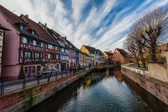 Partially wooden traditional family of Alsace houses. Partially wooden traditional architectural family of Alsace houses alongside a canal Stock Images